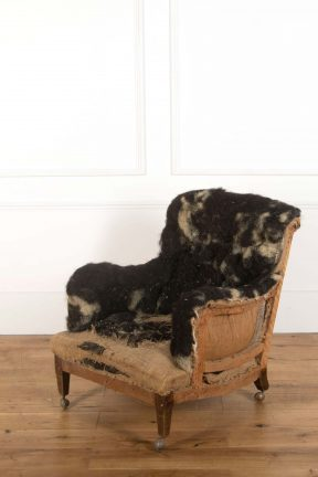 Antique Howard & Sons armchair, in original condition and in need of upholstery
