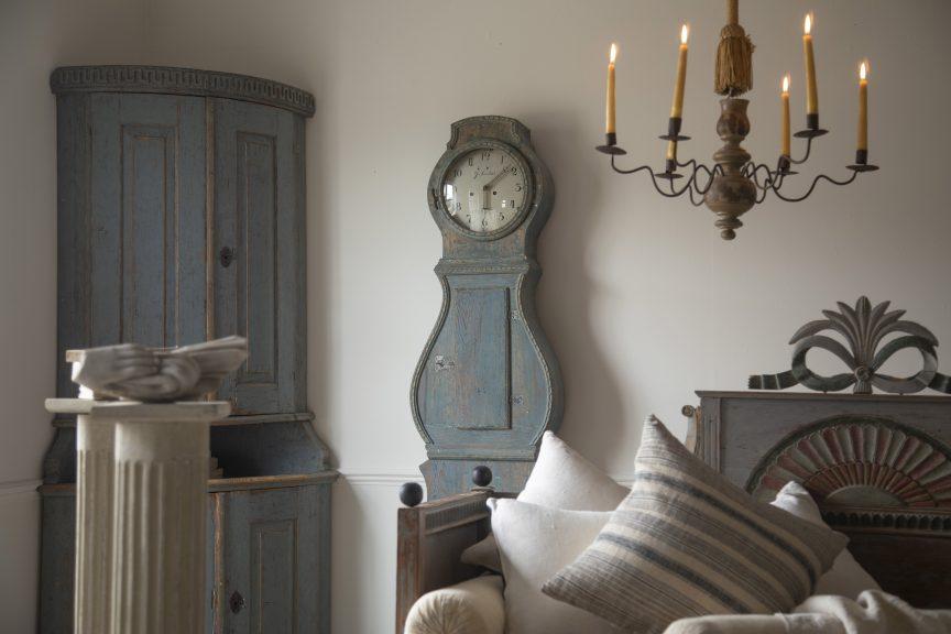 Gustavian corner cabinet, Swedish Mora Clock, antique candelabra, Gustavian bed