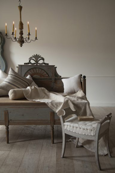 Gustavian bed, Swedish stool, antique candelabra, antique textiles