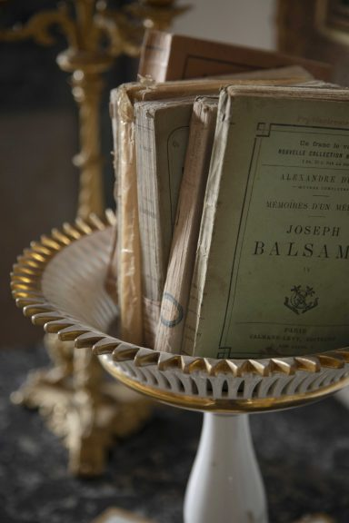 French compote dish with antique French books in