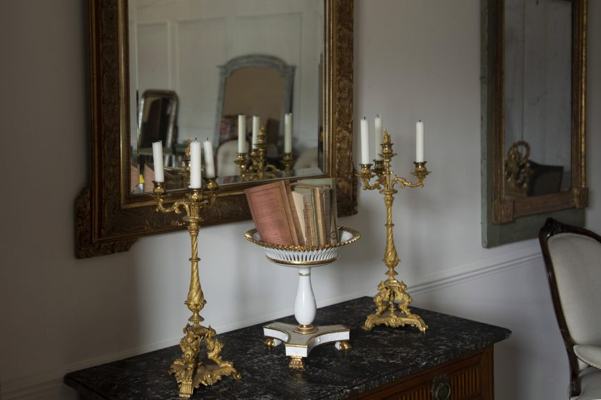 French antique candlesticks, marble top commode, French compote dish and giltwood mirror