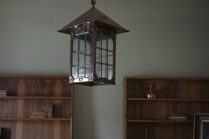Arts & Crafts copper lantern and Gordon Russell bookcases