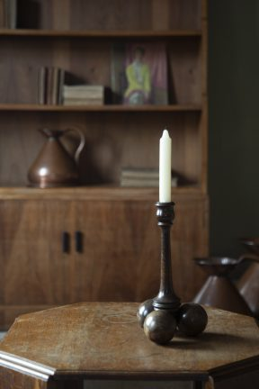 Arts & Crafts candlestick and Gordon Russell bookcases