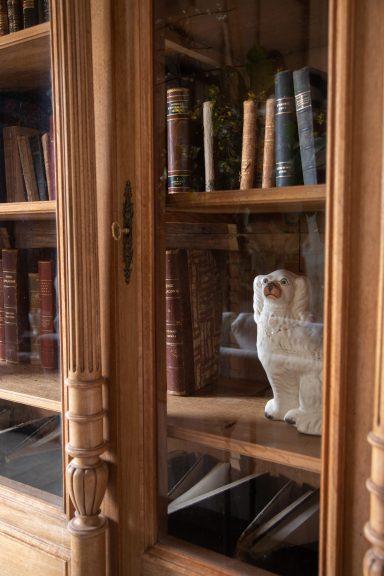 Antique bookcase, Staffordshire dogs