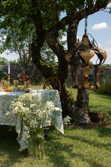 Summer tablescape with antique tableware and antique serving pieces